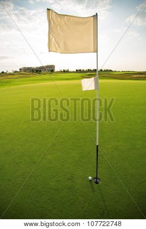 Golf Course And Flag On The Golf Course
