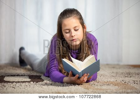 Ten years old girl with a book