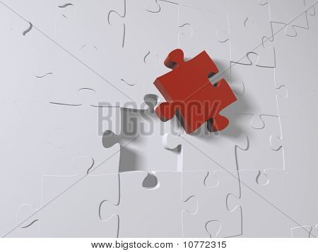 A red puzzle piece on white pieces