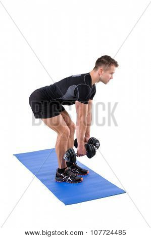 Young man shows starting position of Standing Bent Over Dumbbells Row workout, isolated on white