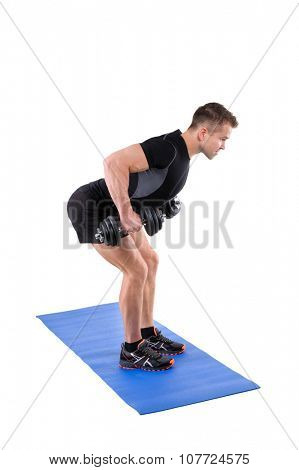 Young man shows finishing position of Standing Bent Over Dumbbells Row workout, isolated on white