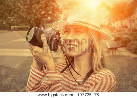 Woman with camera on the street.