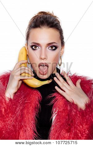 Woman Holding A Banana As Telephone And Having Fun