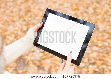 Woman using tablet outdoors