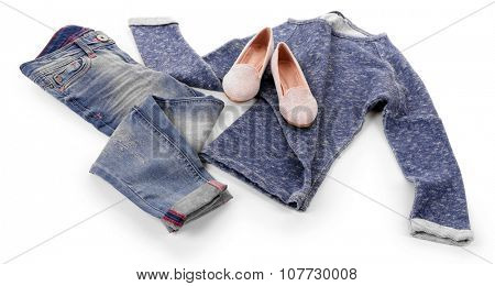 Blue jeans and pullover with shiny pink shoes isolated on white background