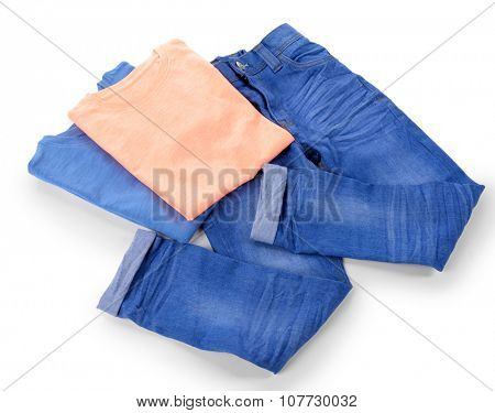 Blue jeans with colourful cotton T-shirt isolated on white background