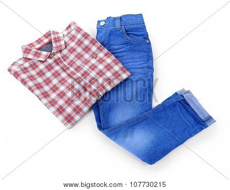 Blue jeans with red plaid shirt isolated on white background