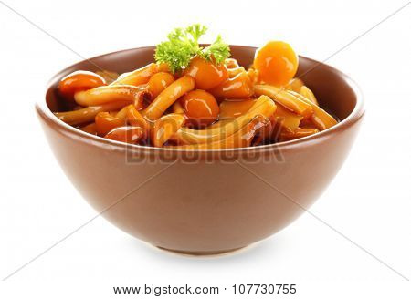 Delicious marinated mushrooms in bowl isolated on white