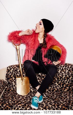 Fashion Beauty Woman Sitting On Leopard Sofa And Licking Candy