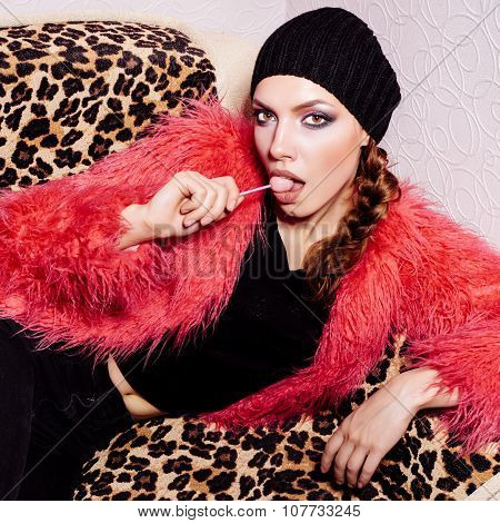 Fashion Swag Girl Wearing Black Dress And Beanie And Pink Fur Coat
