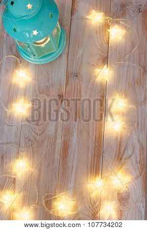 Christmas frame with illuminated festoon and lantern