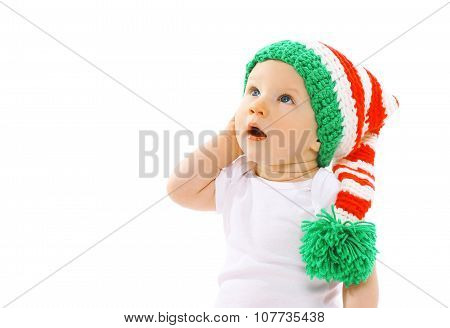 Cute Child In Knitted Gnome Hat Surprised Looking Up On A White Background