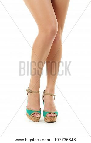 Female Legs In Green High-heeled Shoes On White Background