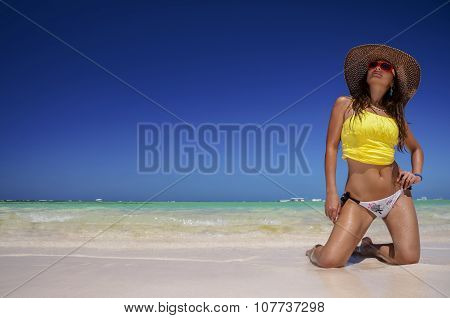 Young Woman Relaxing On Beach And Enjoying The Nice Weather