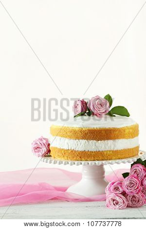 Sweet Cake On Cake Stand On White Wooden Background