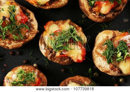 A frying pan with stuffed mushrooms on the table, close-up