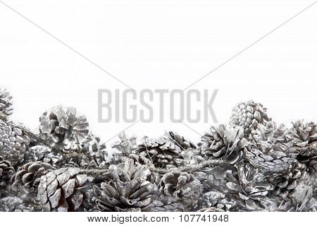 Christmas background with pinecones decoration on white