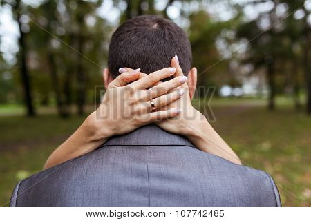 Woman Hugging A Man In The Park