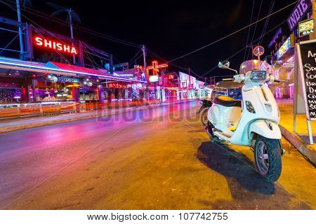 LAGANAS, GREECE - AUG 24, 2015: Main street of the Laganas town at night on Zakynthos, Greece. Laganas is a very popular holidays destination full of nightclubs, bars, restaurants and souvenir shops.