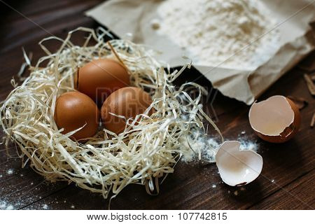 Eggs And Flour Are On The Dark Table