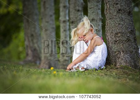 Shy Little Girl In The Park