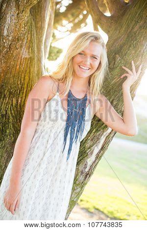 Young girl in flowing dress in hazey glowy sun