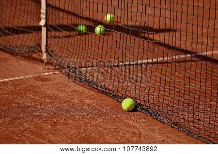 Tennis Balls On Tennis Clay Court