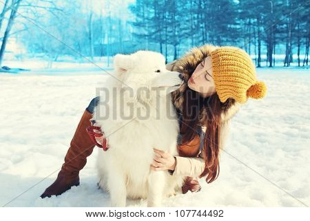 Happy Woman Owner And White Samoyed Dog In Winter Day