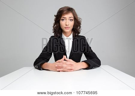 Portrait of sad disapointed pretty curly woman in black jacket