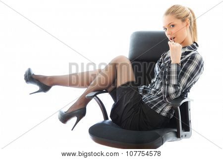 Beautiful sexy businesswoman on armchair. portrait