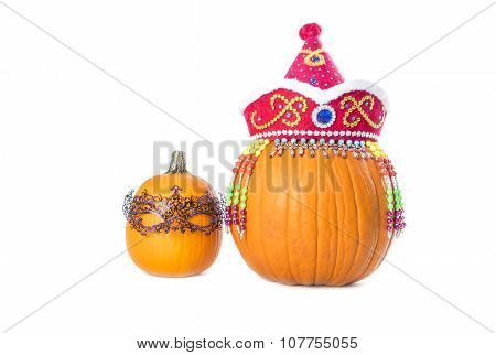 Pumpkins Wearing Hat and Mask Isolated on White