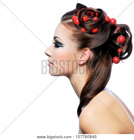 Profile portrait of a cute young woman with creativity hairstyle and fashion make-up
