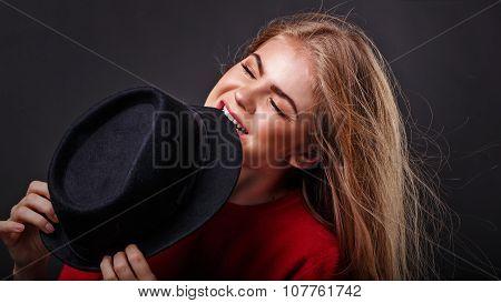 Girl Bites Hat.