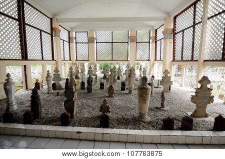 Old grave yard inside Kampung Paloh Mosque in Ipoh, Malaysia