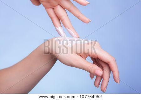 Skin Care. Female Palms With Moisturizing Cream.