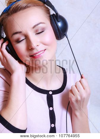 Modern Woman With Headphones Listening Music