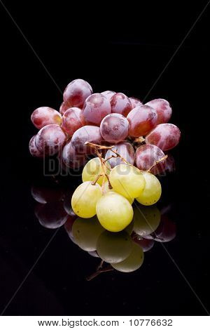 Red & Green Grapes On A Black Background
