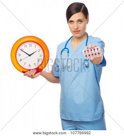 Young doctor showing red pills and clock isolated