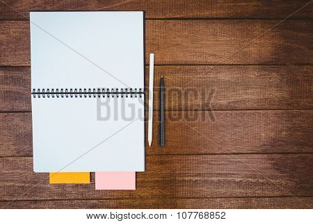 Close up view of a workbook on wood desk