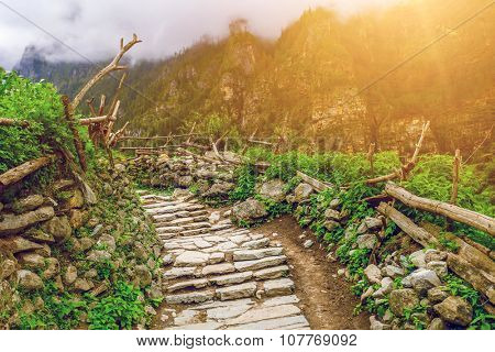 stone path in mountains under sunshine in Nepal, Annapurna trekking