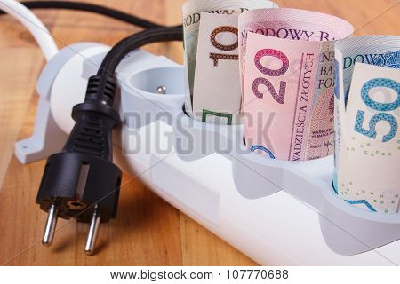 Rolls Of Polish Currency Money In Electrical Power Strip And Disconnected Plug, Energy Costs