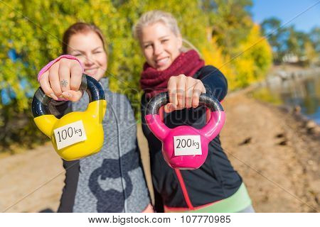 Fit Women Working Out With Kettle Bells