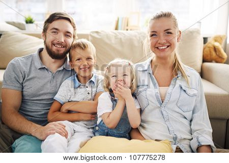 Happy family in casualwear relaxing at home