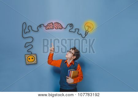 Teenage boy in glasses holding books showing thumb up charging c