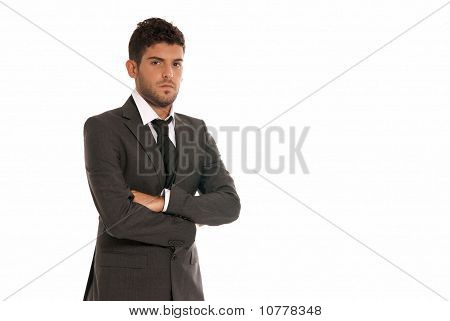 Young Businessman With Copy-space Looking Serious Arms Crossed Isolated On White Background