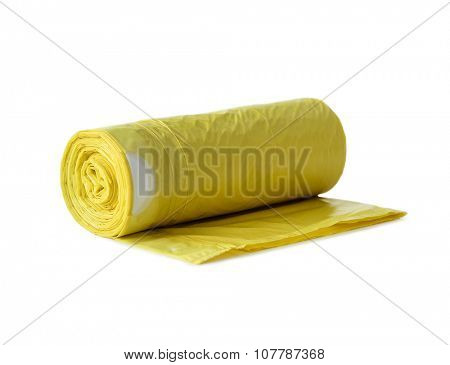 roll of yellow garbage bags isolated on white background