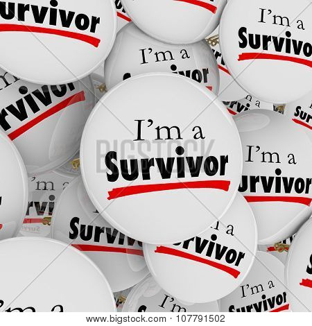 Iâ??m a Survivor words on white buttons or pins to illustrate being determined, courageous, brave and perservering against the odds