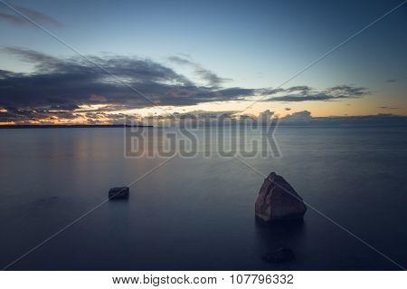 After Sundown Dusk Over Stony Seascape