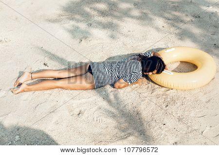Girl Lying On The Beach, Sunbathing And Relaxing