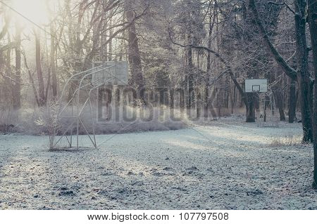 Abandoned Street Basketball Hoop On Winter Frosty Morning